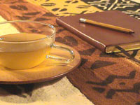 teacup and notebook pencil