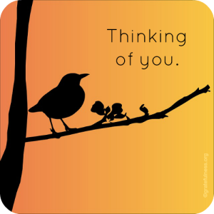 Silhouette of a bird singing on a branch against a bright orange background.