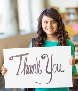 Hispanic_girl_with_thank_you_sign_GGSC