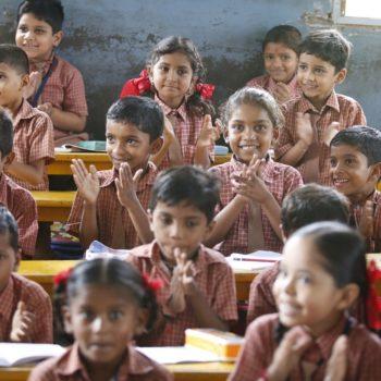 classroom of happy children