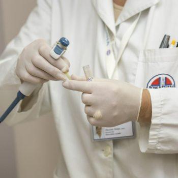 medical doctor or nurse holding an instrument
