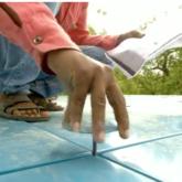 putting together blue modular roof panels