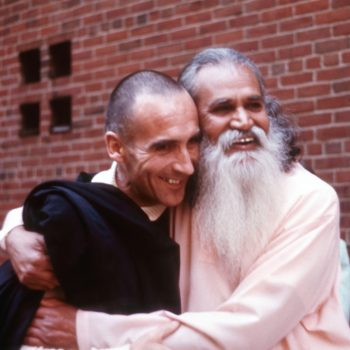 Br. David Steindl-Rast and Swami Satchidananda enjoy a warm hug.