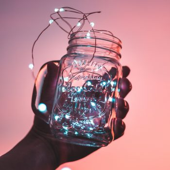 mason jar filled with a tangle of string lights